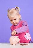 A small charming Caucasian baby plays Stock Image