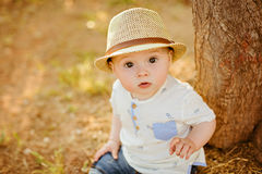 Small charming and very beautiful baby boy with big brown eyes i royalty free stock photos