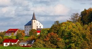 Small chateau in village. In Czech republic Priseka. Beautiful view to autumn fall vysocina countryside. Rural scene with colored trees Stock Images