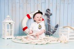 A small cheerful captain in a maritime interior Stock Photos