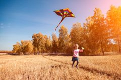 Girl with kite stock image