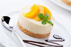Small Cheesecake With Poached Peaches Stock Image