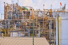 A small Chemical Plant with multi colored pipes which could pose a hazard to public health. A chemical plant with windsock at the top showing the direction of Royalty Free Stock Photography