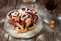 Small cherry buns with powdered sugar Stock Photography