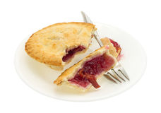Small cherry pie pieces on plate with fork Royalty Free Stock Images