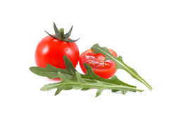 Small cherry tomato and arugula. Over white background Royalty Free Stock Image