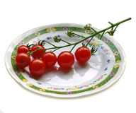 Small Cherry Tomatoes. A plate with cherry tomatoes (also known as super sweet tomatoes) and water drops Stock Photo