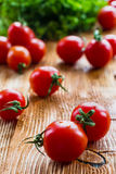 Small cherry tomatoes on wooden background. Selective focus Royalty Free Stock Image