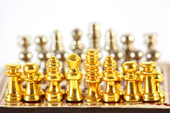 Small chess stand on checkerboard Royalty Free Stock Photos