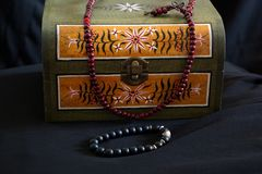 Small chest with old school painted ornaments and beaded necklace. Small chest with old school  painted ornaments and beaded necklace stock image