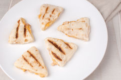 Small chicken quesadilla wedges Stock Photography