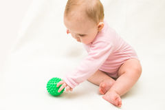 The small child. Plays with a rubber ball royalty free stock images
