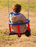 Small child in action. In the playground Stock Photos