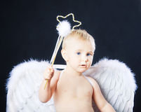 Small child in angel wings Royalty Free Stock Images