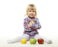 Small child with apples. Royalty Free Stock Photos