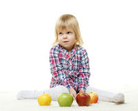 Small child with apples. Stock Photos