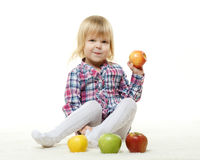 Small child with apples. Royalty Free Stock Photo