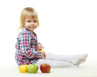 Small child with apples. Royalty Free Stock Images