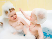 Small child in bath Stock Images