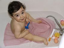 Small child is bathing in water-filled tub Stock Photo