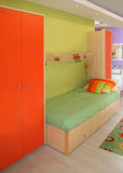 Kids bedroom. Small child bedroom with modern green and orange furniture Stock Images