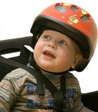 The small child in a bicycle helmet. Isolated on a white background stock photo