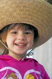 Small child, big hat, and big smile. Stock Image