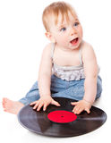 The small child with a black gramophone record. Isolated on white background Royalty Free Stock Image