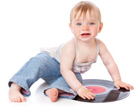 The small child with a black gramophone record. Isolated on white background Royalty Free Stock Images