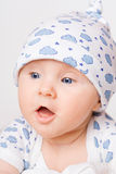 Small child in blue cap Royalty Free Stock Photos