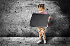 The small child with a board for drawing Stock Image