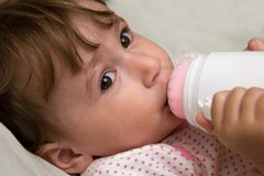 Small child with bottle Royalty Free Stock Image