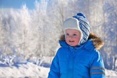 Small child the boy on walk in the winter in park Royalty Free Stock Image