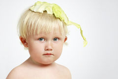 Small child with cabbage Stock Photos