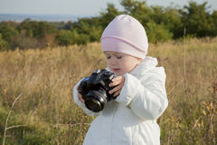 Small child with a camera Royalty Free Stock Photography