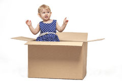 A small child in cardboard boxes royalty free stock images