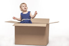 A small child in cardboard boxes stock image