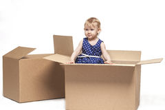 A small child in cardboard boxes Stock Images