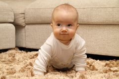 Small child on carpet. Small child crawling on carpet Royalty Free Stock Photo