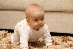 Small child on carpet royalty free stock photos