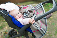 The small child in a carriage. royalty free stock images