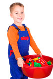 Small child is cleaning up blocks Royalty Free Stock Image