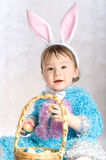 A small child in clothes bunny Stock Images