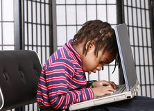 Small child with a computer Stock Images