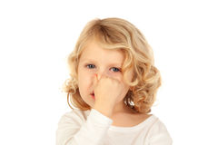 Small child covering his nose Stock Images