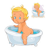 Small child crawls out of the bath Royalty Free Stock Photography