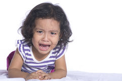 Small child is crying hard on white background. Stock Photos