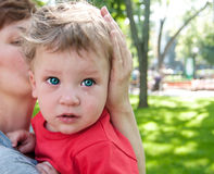 Small child crying at her mother's hands Royalty Free Stock Images