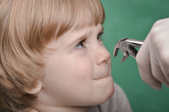 Small child and dental instrument Royalty Free Stock Image