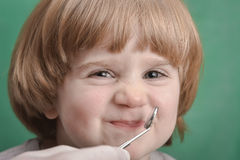 Small child and dental instrument Royalty Free Stock Photos